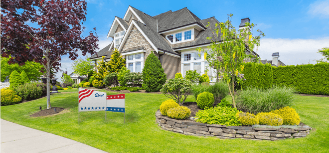 real estate yard sign on display in front of a home